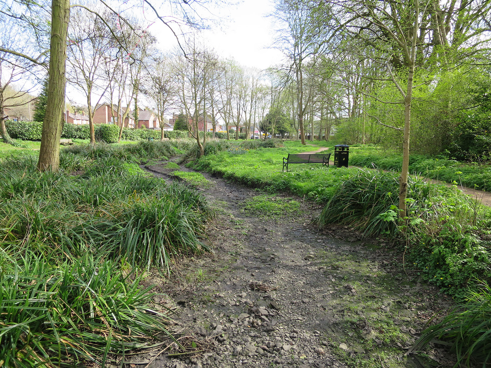 The bare river bed of the River Chess in Chesham, Buckinghamshire.